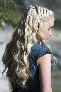 The Targaryen wears pulled-back rope braids en route to Mereen. - HarpersBAZAAR.com