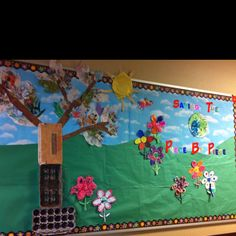 Earth Day bulletin board using recycled materials.