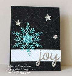handmade Christmas card from  Creatively LA ... striking and sophisticated graphic look ...turquoise die cut snowflake from metallic paper ... JOY die cut in silver ... black card base with embossing folder curlie cues ... fab card! ...