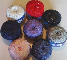 Venera, a lovely sparkly sequined knitting yarn at only £2.15 per 100g ball from The Knitting Wool Store- http://www.the-knitting-wool-store.com/sequined-knitting-yarn.html