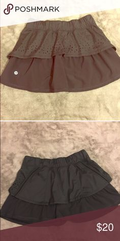 Lululemon skirt Black Lululemon skirt with side pockets size 2 has those built in shorts underneath you can always cut them out which I have done with other lulu products. Great condition lululemon athletica Skirts