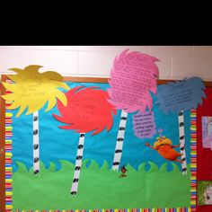 """""""The Lorax"""" bulletin board!- This is adorable    I made this for March after seeing in on Pinterest.  It is so cute and easy!!  I also had my kids make their own trees from dot markers on coffee filters and made small striped trunks.  Soooo cute!!"""