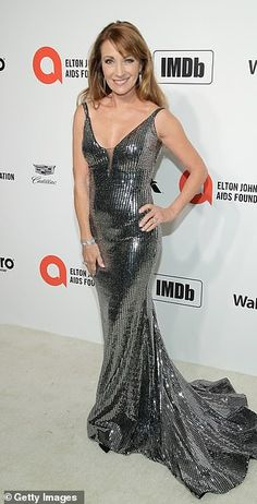 Age-defying:Jane Seymour, 68, dazzled in a plunging metallic frock...