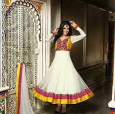 White designer anarkali suit with embellished border in yellow and golden colour lines paired up with white chudi style kameez and matching duppatta to make you look stylish best.