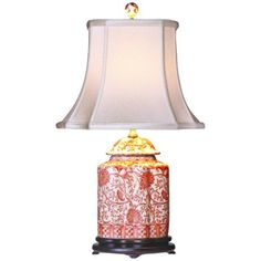 "Coral Porcelain Scalloped Tea Jar Table Lamp - features a porcelain scalloped tea jar base decorated with coral hues. An off white French oval shade sits on top. A three-way socket gives you more lighting control.      Porcelain base.     Coral-colored floral motif.     Off white French oval shade.     Takes one 100 watt three-way bulb (not included).     23"" high.     Shade is 7"" wide by 9"" deep across the top.     Shade is 13"" wide by 14"" deep across the bottom.     Shade is 11"" high."