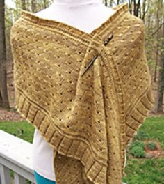 I was so 'enamored' of some of the techniques used in Fabergé that I wanted to use them again! This shawl or stole is also knit from the bottom up beginning with a pleated ruffle and then a row of beads framed by horizontal braids. The body is knit in a textured eyelet stitch. The sides of the stole are slanted with increases on one end and decreases on the other to give a tilted rectangle shape. The top edge of the stole features the framed beads again plus a tiny ruffle.