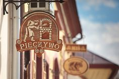 Szyldy ozdobne Hotels, Hanging Signs, Shop Signs, Prehistoric, Wrought Iron, Signage, Restaurants, Painting, Art