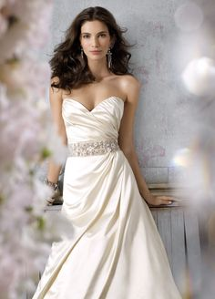 Jim Hjelm #8054: Antique Silk Faced Satin modified A-line bridal gown, strapless draped bodice with sweetheart neckline, natural waist with crystal beaded trim, asymmetrical draped skirt, chapel train.