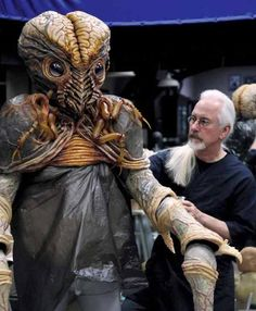 Rick Baker applies some finishing touches to one of his alien creations for 'Men in Black III' (2012). This particular creature (homaging the Metaluna Mutant from 'This Island Earth') is briefly seen in the Long Island scenes.
