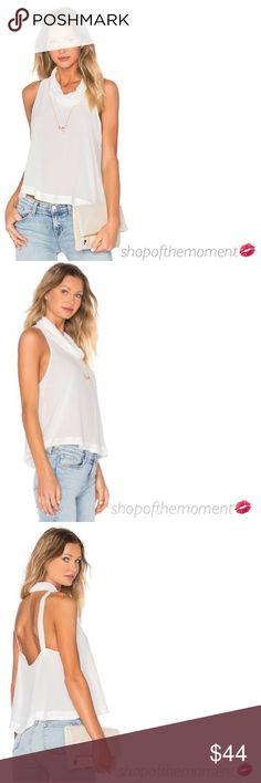 """🦄🆕 Free People ❉ City Lights Cowl Top ❉ Ivory Free People  City Lights Cowl Top  in Ivory Brand New with Tags in Manufacturer's Packaging  🦄🦄🦄🦄🦄🦄🦄🦄🦄🦄🦄🦄  A sleeveless semi sheer cowl neck top with dropped armholes and a daring open back cuts a slinky sexy silhouette with a gorgeous drape. Absolute fashion perfection!   Approximate Measurements: Length: 22"""" Fabrication:  84% Rayon/16% Viscose  🦄🦄🦄🦄🦄🦄🦄🦄🦄🦄🦄🦄  ✗ Drama ✗ Trades ⚡️Fast Shipper ☆☆☆☆☆ 5 star seller  💋…"""