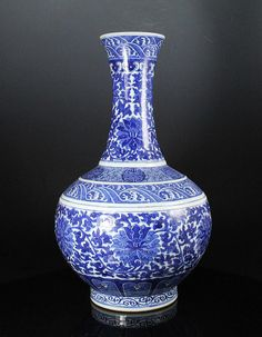 RARE ANTIQUE CHINESE BLUE AND WHITE BOTTLE VASE WITH QIANLONG MARK dating to the 18th-19th century. The vase stands an impressive 15.75 inches. It is molded in bottle form with raised ribs around the shoulder and tapers to a narrow neck that flares back out at the top rim. The art work is of excellent quality and exhibits a vibrant and bold cobalt blue. It stands on a tall foot that is extremely smooth to the touch. The underside of the vase is marked with a underglaze blue Qianlong seal…