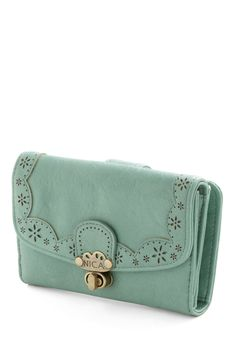 Pretty Pay-Mint Wallet   Toss it in your shoulder bag before heading downtown, or carry it solo alongside your buttoned blouse and floral skirt!