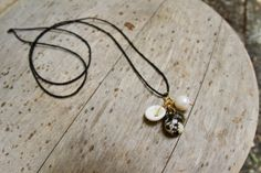 Gold Shell Charm Black Hemp Necklace, SOLD