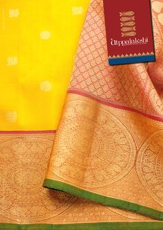 Yellow kancheevaram Saree with annam and chakkram all over the saree with a big…