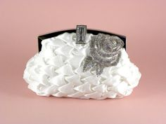 Gorgeous white satin bridal clutch with removable crystal rose brooch and rhinestone studded closure!