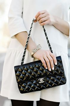 white dress, black Chanel quilted bag, bow bracelet, white manicure
