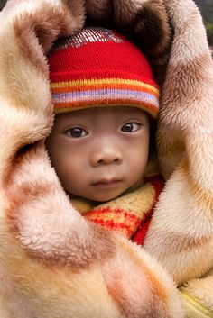 China ~ Baby with Red Hat   by Steven House, via Flickr