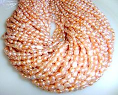 '3 Strands Peach Champagne Flatback Fresh Water Pearls' is going up for auction at  4pm Mon, Sep 10 with a starting bid of $5.