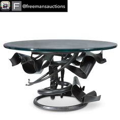 "Repost from @freemansauctions using @RepostRegramApp - Hot Bid Alert! ""Albert Paleys Alluring Coffee Table Takes Center Stage at Freemans"" What you see: A coffee table created in 1991 by American sculptor Albert Paley. It is estimated at $8000 to $12000.  Who is Albert Paley? He is one of the worlds foremost metal sculptors. He might be best known for the Portal Gates that he created for the Renwick Gallery at the Smithsonian Institution in Washington D.C. Hes made about 50 coffee tables to…"