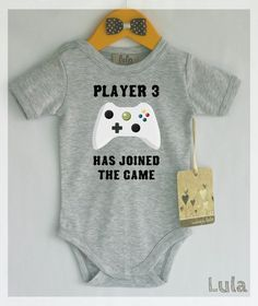 Player 3 had joined the game onesie https://www.etsy.com/listing/208505281/funny-baby-onesie-video-games-baby