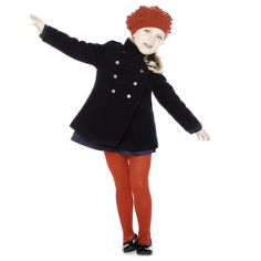 Navy Military Coat - In this photograph of a young girl wearing a military inspired jacket, again with the double buttoning that is commonly seen in military uniforms, it can be seen that military influenced fashion is being worn by all different ages.