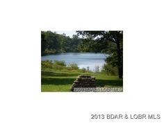 1.83 Acres includes 5 Building Lots. All level lots with water frontage. Private Lake for lot owners. Water and Electric available in Macks Creek MO