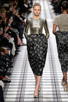 Wang toed the line between old and new, Paris and New York nicely. Or at least, it was a start to what will hopefully be his beat at Balenciaga. it was neat to see him rework old classics in new ways, turn the heat up a bit on feminine ideals, whether that's a chain mail-like top to a poof-skirted dress or the tread mark patterns artfully worked into ladylike dresses and separates.