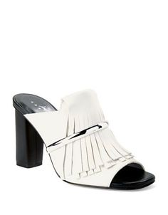 Uptown boho with silvery hardware over smooth leather fringe, all in an open toe design.