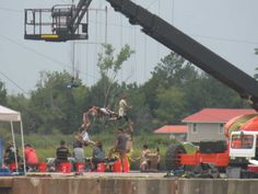 Set of Iron Man 3 in on waterfront in Wilmington NC.  My daughter took this pic from our far vantage point and the zoom captured the stunt work perfectly.  They were filming Fri July 13, 2012 at the Wilmington waterfront. Thrilling.    Drop Box - Dawn King - Picasa Web Albums