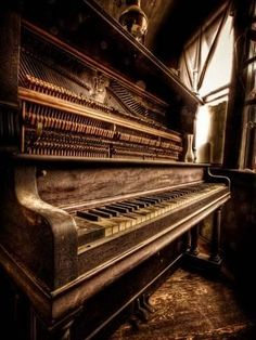 Nothing much more beautiful and peaceful than a used, loved piano in a quiet corner. Oh to think of the decades of music played on this piano. Sound Of Music, Music Is Life, Pop Music, Vieux Pianos, Band Poster, The Piano, Grand Piano, Old Pianos, Diesel Punk