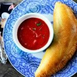 Easy Homemade Calzones with marinara sauce for dipping. This is the most delicious and easy dinner. My family loved it! I made it just like Ree did, but you could easily adapt it with different pizza toppings inside. YUMMY!
