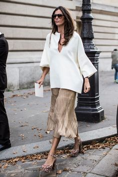 Oversized shirt spotted during #PFW combined with gold pleated skirt. #catchatrend #streetstyle #SS15 #oversized #white #shirt @sommerswim