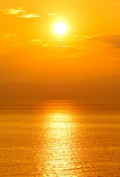 Picture of Image shows a setting sun over the ocean stock photo, images and stock photography. Beautiful Sunset, Beautiful World, Beautiful Places, Beautiful Pictures, Shades Of Yellow, Mellow Yellow, Yellow Sun, Color Yellow, Bright Yellow