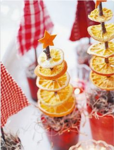 diy christmas gifts two christmas tree ornaments made from dried orange slices spiked on a twig with little orange cut out star on top near other decorations small candle Festival Decorations, Christmas Tree Decorations, Christmas Tree Ornaments, Homemade Halloween Decorations, Christmas Cupcakes, Table Decorations, Winter Christmas, All Things Christmas, Christmas Time