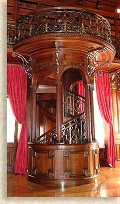 I'd just like to take a moment to remind everyone that the library in the Biltmore Estate in Ashville, NC not only features this amazing staircase, but also includes a number of secret passage ways that run directly to the library from various guest bedrooms.    For secret nighttime library assignations, guys. It's like the Vanderbilts were practically inviting you to meet up in the library.
