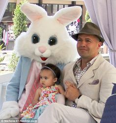 Proud father Billy poses up with his daughter and the Easter bunny