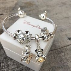 This iconic Disney Minnie Charm is perfect to add fun to your PANDORA ESSENCE bracelet. With blushing pink PANDORA Rose detail, wear with the matching Mickey charm for the ultimate pairing. Disney Pandora Bracelet, Pandora Bangle, Disney Jewelry, Pandora Jewelry, Pandora Pandora, Cute Jewelry, Charm Jewelry, Jewelry Accessories, Pandora Charms