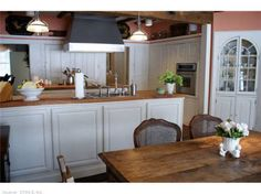 Wall oven and china cabinet add nice details. Find this home on Realtor.com