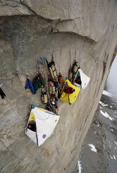 This is nuts!!!! Hanging in a tent off a cliff by ropes