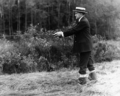 President Calvin Coolidge fishing in a stream near his family's home in Plymouth, Ver., on July 14, 1931. (AP)