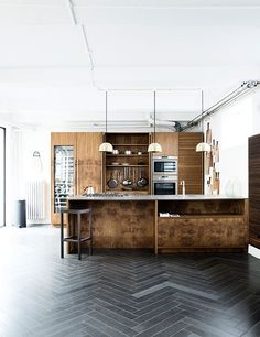 Find inspiration in these stylish kitchens that create ample for cooking, entertaining, and more