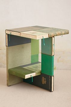 Side Table | Anthropology - what's more fitting than a side table for books made of books?!