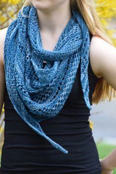 I love the pretty teals of this yarn. It reminds me of summer, so I matched it up with an airy, lacy pattern. This scarf is a triangle worke...