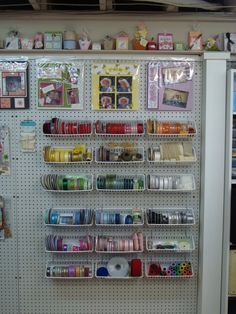 Small plastic white bins to put on peg  board... Hold up with pegs...Dink's Craft Studio, Ribbon Station - Scrapbook.com