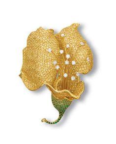 A YELLOW SAPPHIRE, TSAVORITE GARNET AND DIAMOND CLIP BROOCH, BY ANGEVIN