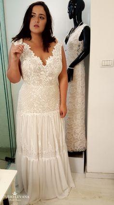 Plus size boho fit and flare wedding dress with fringes. Studio Levana