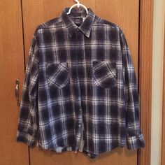 Men's large flannel long sleeved top Men's size large, soft cotton flannel shirt, black, dark grey, and white plaid. Worn lightly and hung to dry. No marks, tears, or signs of wear. Saucatuck Tops Button Down Shirts