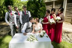 Wedding Photography - Ceremony - Garden - Bride - Groom - Bridal party - Grey suit - Red tie - Red dress