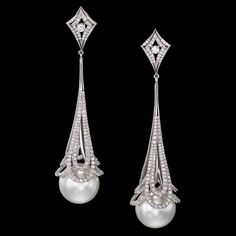 Pearls in Lace earrings feature flawless South Sea pearls drip from delicate laces of platinum accented with 600 white diamonds.  Call (949) 715-0953 to purchase or click below for additional information.