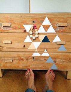 Distressed furniture w/ painted accents  Triangles, man.